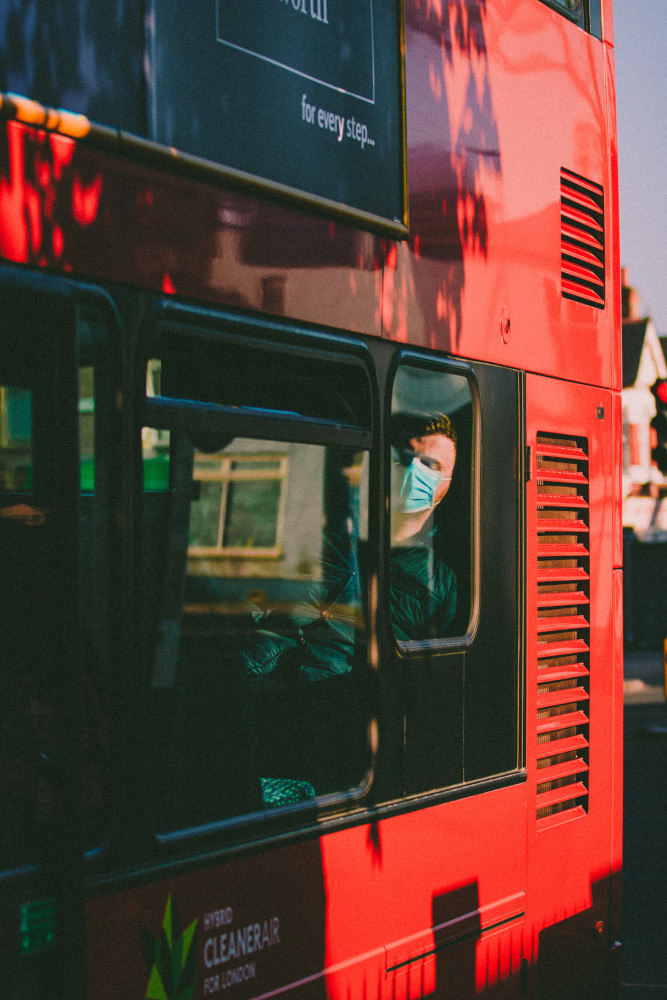 Man sleeping on a bus during the COVID-19 outbreak in London